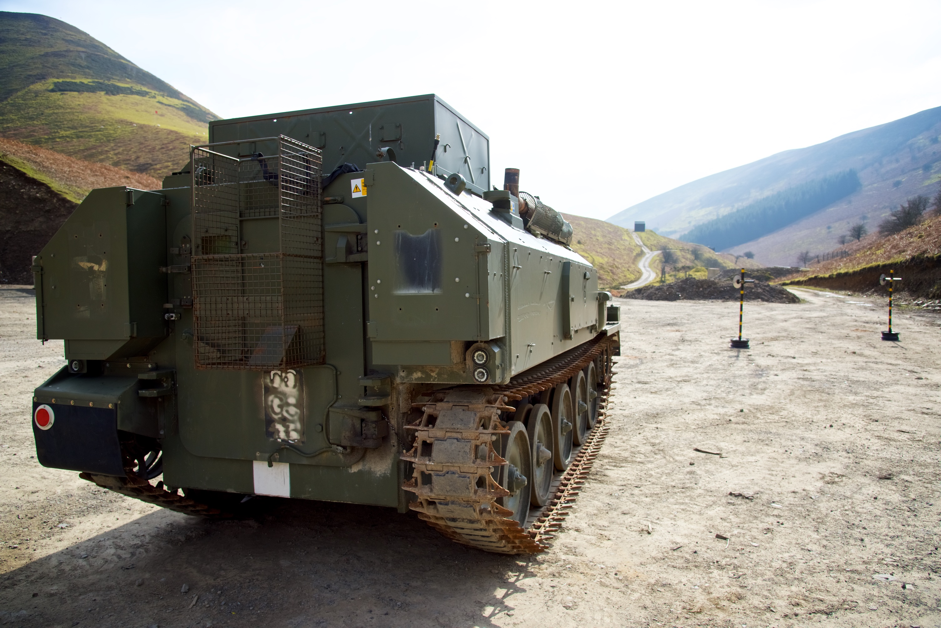 Armoured vehicle ready for steel pot or gravel pit under belly mine blast test